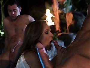 Julia Ann deep throats a group of knobs in a pool