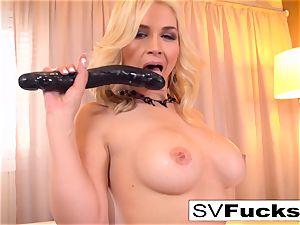 Sarah Vandella uses a large toy