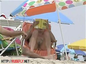 Candid naked beach teen bootie voyeur